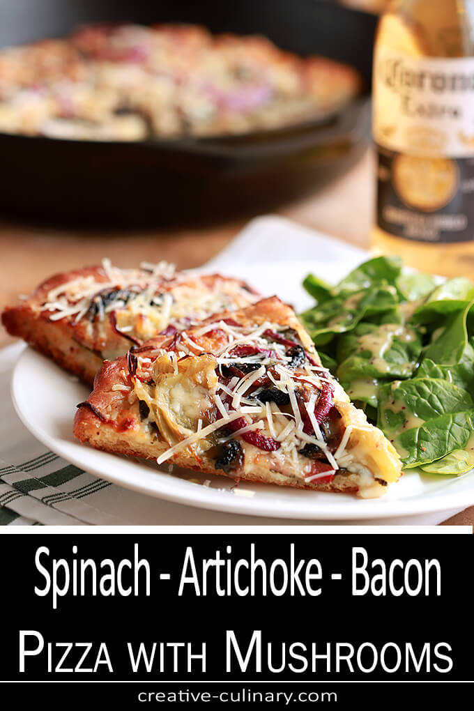 Spinach, Artichoke, Bacon and Mushroom Pizza Served on a White Plate with a Beer