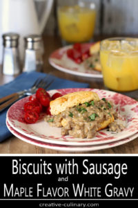 Table set with Servings of Biscuits with Sausage and Maple Flavor White Gravy and OJ