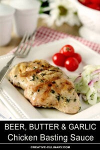 Beer, Butter, and Garlic Chicken Basting Sauce on Chicken Thighs Garnished with Herbs Served with Cherry Tomatoes