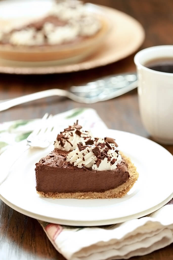 A slice of French Silk Pie with Bourbon on a white plate.
