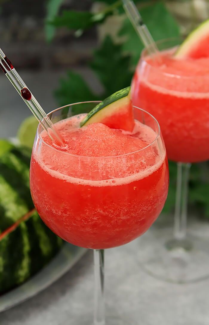Fresh Watermelon Frosé in a Wine Glass with a Straw