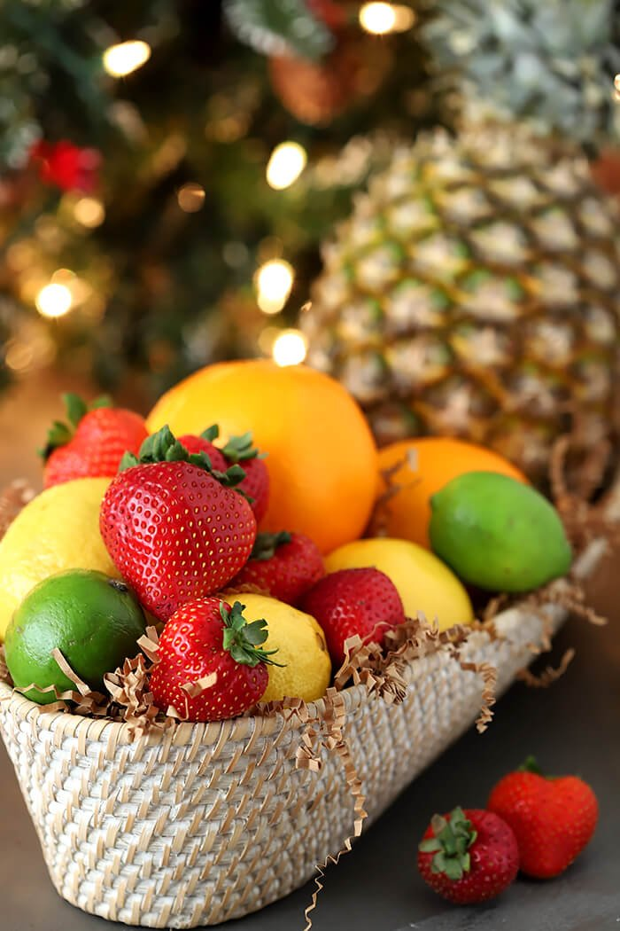 Basket of Fresh Fruits for Punch including Pineapple, Oranges, Lemons, Limes, and Strawberries
