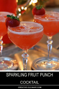 Sparkling Fruit Punch Champagne Cocktail Garnished with Fresh Strawberry