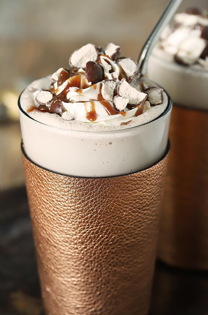 Guinness Vanilla Malted Milkshake with Irish Whiskey Whipped Cream topped with caramel and malted milk balls.