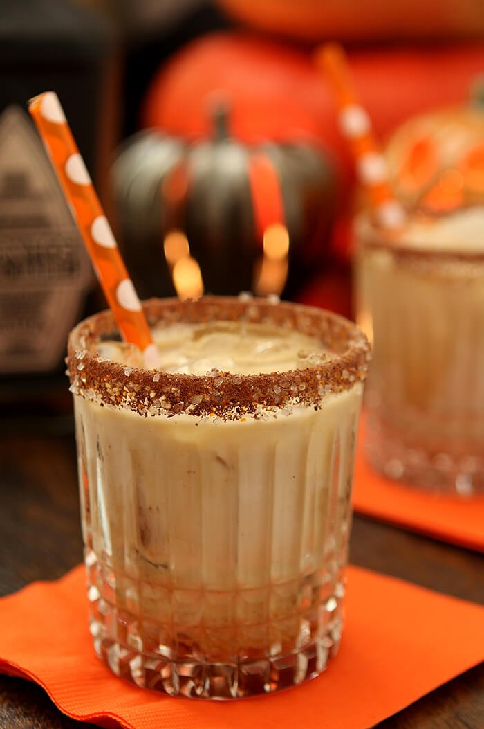 Tequila, Kahlua, and Cream Cocktail in a Highball Glass with an Orange Straw