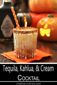 Tequila, Kahlua, and Cream in Highball Glass Rimmed with Cocoa and Sugar Crystals
