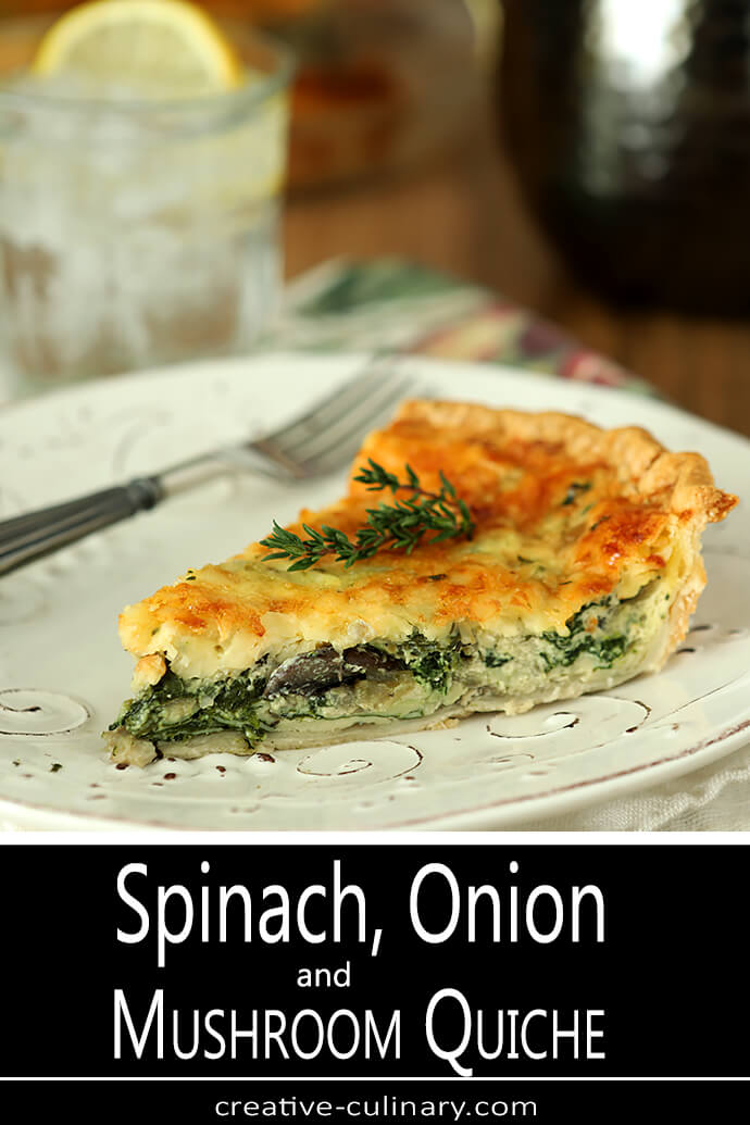 Spinach, Onion, and Mushroom Quiche Slice on a Round Plate with a Fork