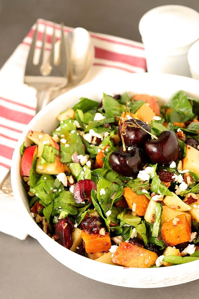 Sweet Potato and Spinach Salad with Pecans, Cherries and Goat Cheese in a Round White Serving Bowl