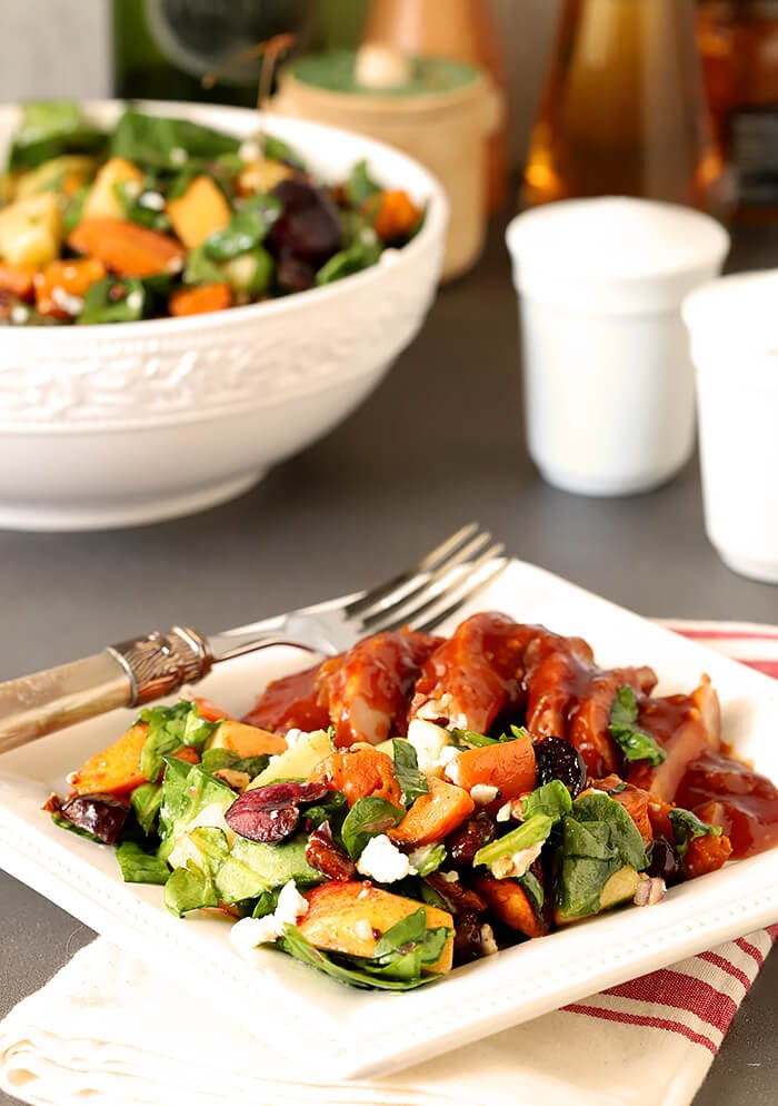 Sweet Potato and Spinach Salad with Pecans, Cherries and Goat Cheese Served with Barbecued Smoked Chicken on a Square Plate