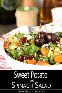 Sweet Potato and Spinach Salad with Pecans, Cherries and Goat Cheese Garnished with Whole Cherries