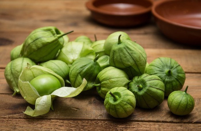 Tomatillos in Husks on Table