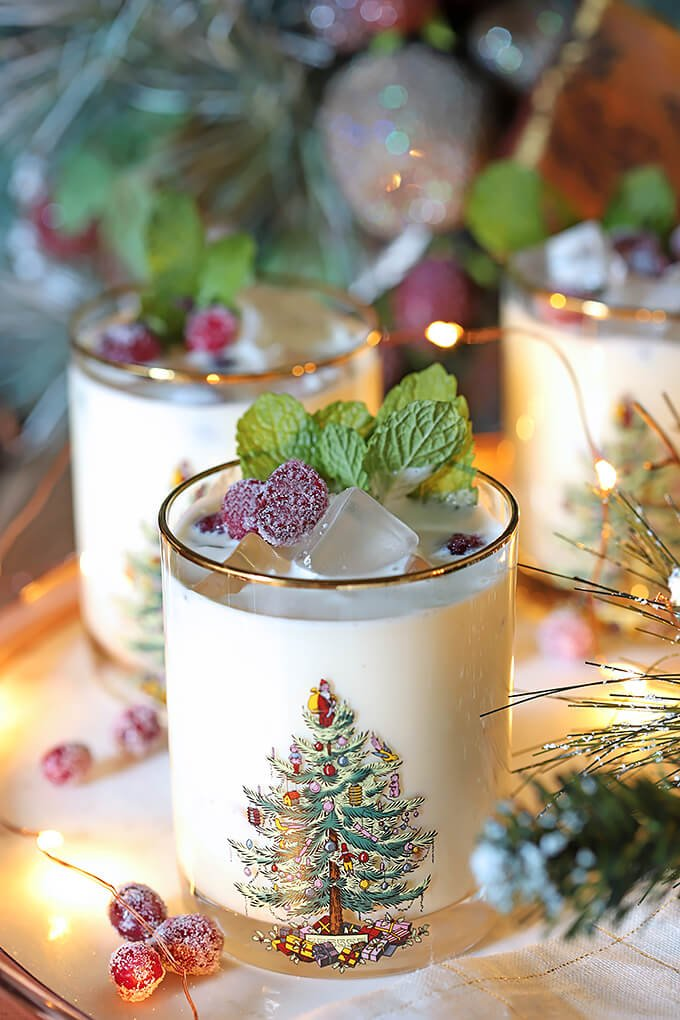 White Chocolate Mint Eggnog Cocktail Garnished with Mint Leaves and Sugared Cranberries