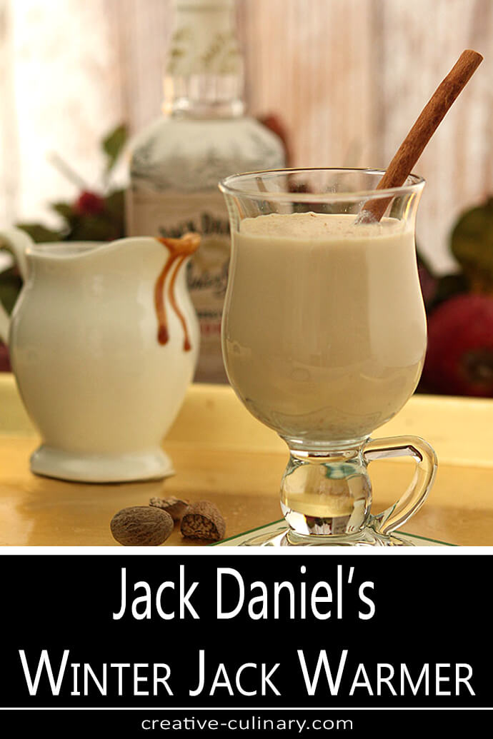 Jack Daniel's Winter Jack Warmer Served in a Clear Glass Mug with a Cinnamon Stick Garnish