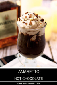 Mug of Amaretto Hot Chocolate with Whipped Cream and Toasted Almonds for Garnish