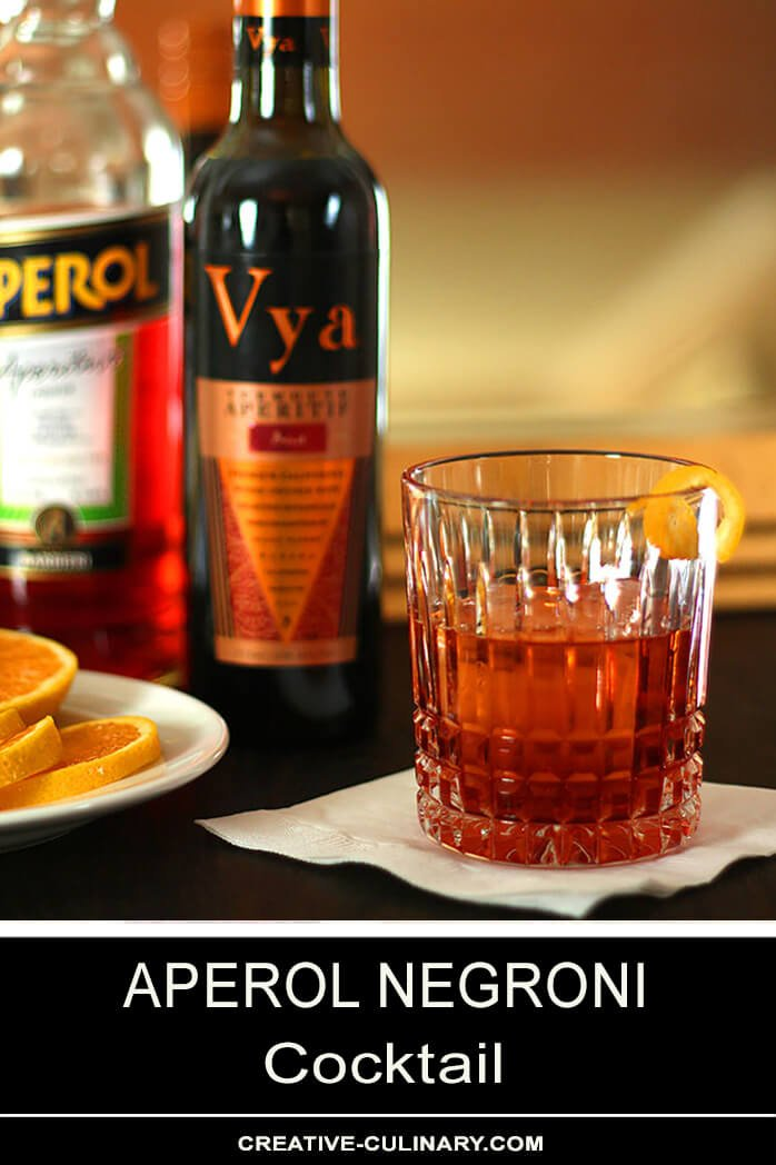 Aperol Negroni Cocktail Served on a Napkin with LemonTwist