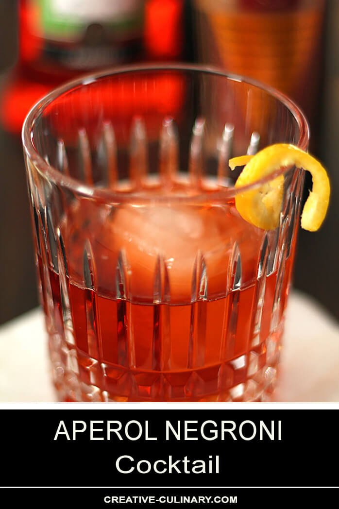 Aperol Negroni Cocktail Served in a Lowball Glass with an Orange Twist