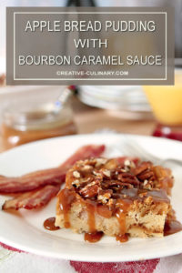 Apple Bread Pudding with Bourbon Caramel Sauce Slice on White Plate with Bacon
