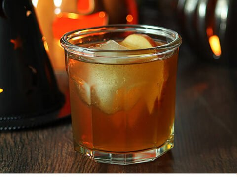Apple Cider, Vodka, and Apple Brandy in a Cocktail with a Large Ice Sphere