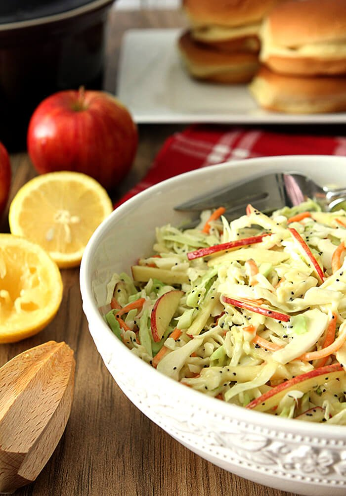 Apple and Poppy Seed Coleslaw in a White Round Serving Bowl