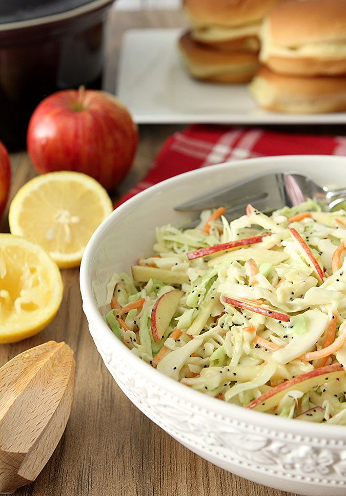 Apple and Poppy Seed Coleslaw in a White Serving Bowl