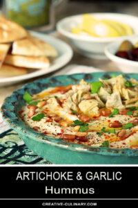 Artichoke Garlic Hummus in a Bluegreen Pottery Dish