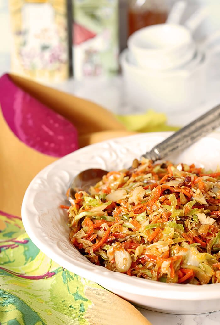 Asian Slaw with Almonds, Sunflower and Sesame Seeds in a White Serving Bowl