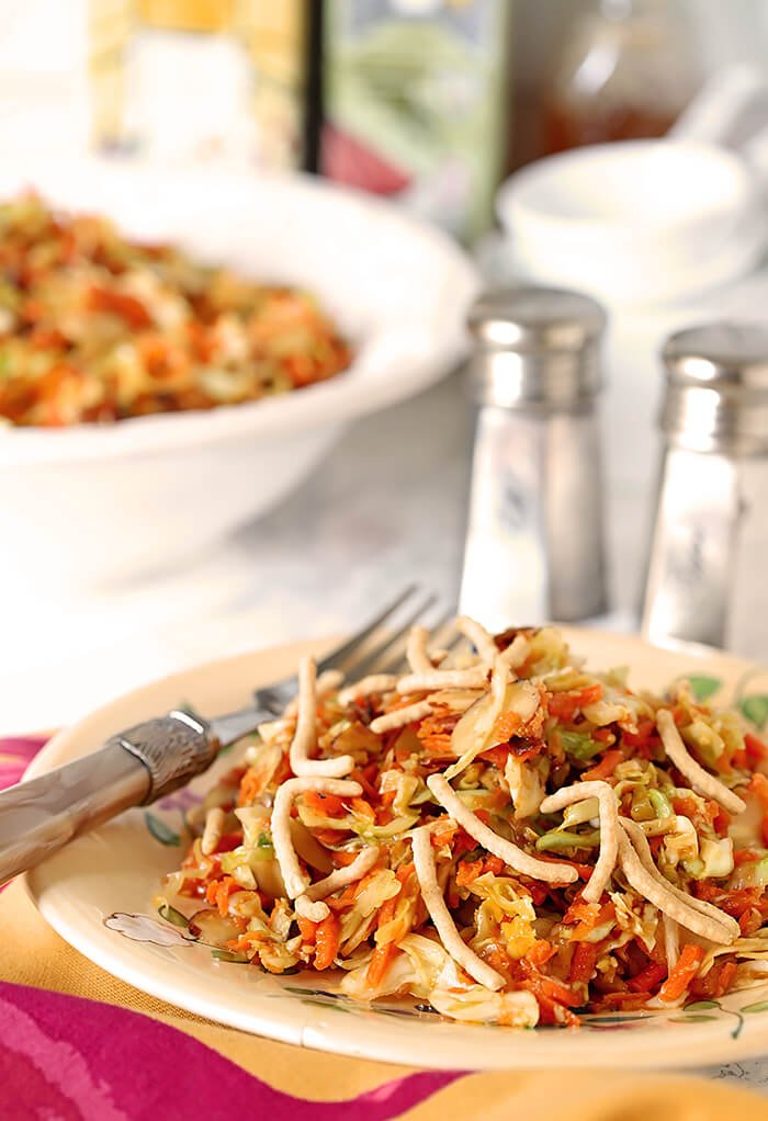 Plate of Asian Slaw with Cabbage and Carrots on Fuchsia and Gold Napkin
