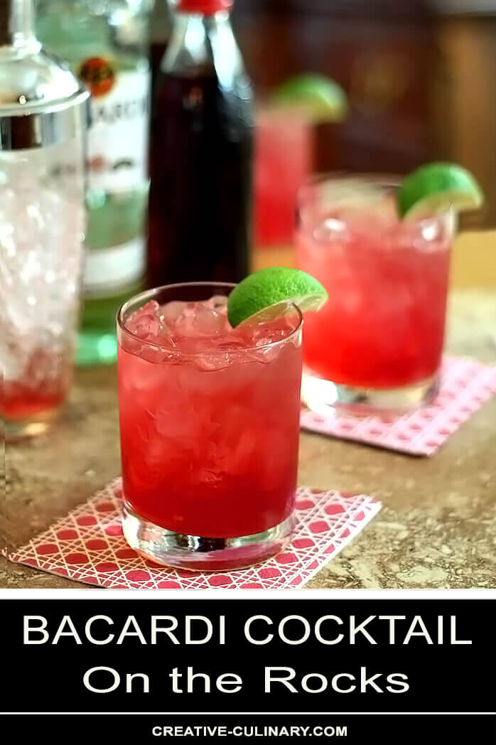 Two Bacardi Cocktails in Lowball Glasses with Lime Garnish