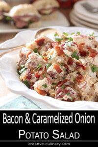 Bacon and Caramelized Onion Potato Salad in a White Serving Bowl