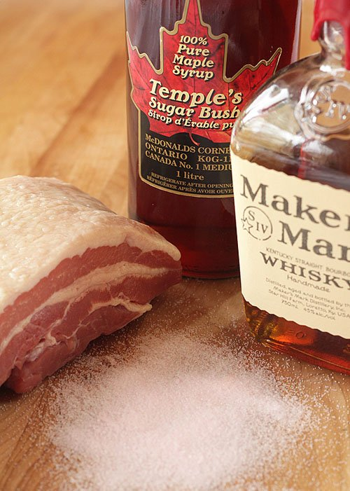 Home-Cured Maple Bourbon Bacon ingredients; pork belly, maple syrup, bourbon, and pink salt.