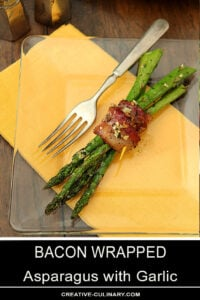 Bacon Wrapped Asparagus with Garlic Served on a Glass Plate with Yellow Napkin
