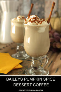 Baileys Pumpkin Spice Dessert Coffee Topped with Whipped Cream and Caramel Sauce and Garnished with a Cinnamon Stick