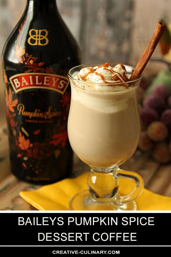 Baileys Pumpkin Spice Dessert Coffee Topped with Whipped Cream and Caramel Sauce with a Bottle of Baileys in the Background