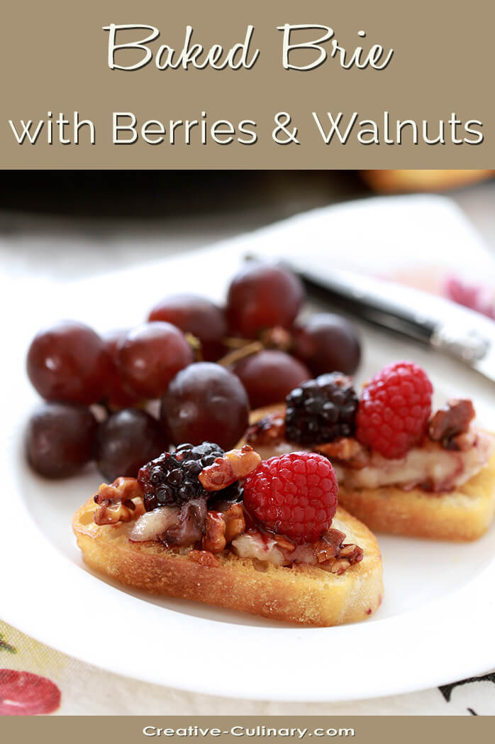 Baked Brie with Berries and Walnuts on a Toasted Baguette Slice