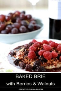 Baked Brie with Berries and Walnuts Served on a White Plate