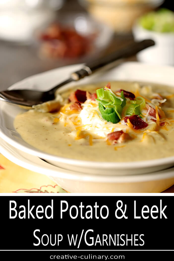 Bowl of Baked Potato Soup with Leeks and Garnishes