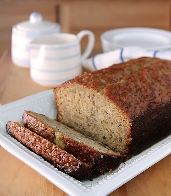 Banana Bread with Pecans and Toffee Glaze Served Sliced on a Serving Plate