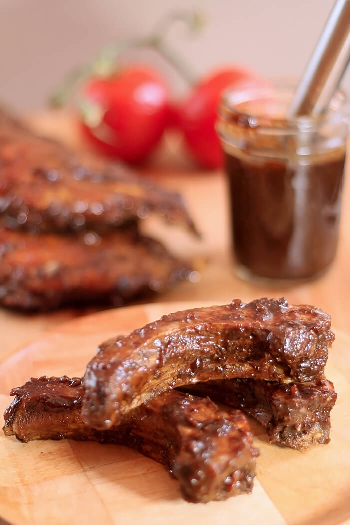 Smoked Ribs with Espresso Barbecue Sauce Pieces cut from Whole Rib
