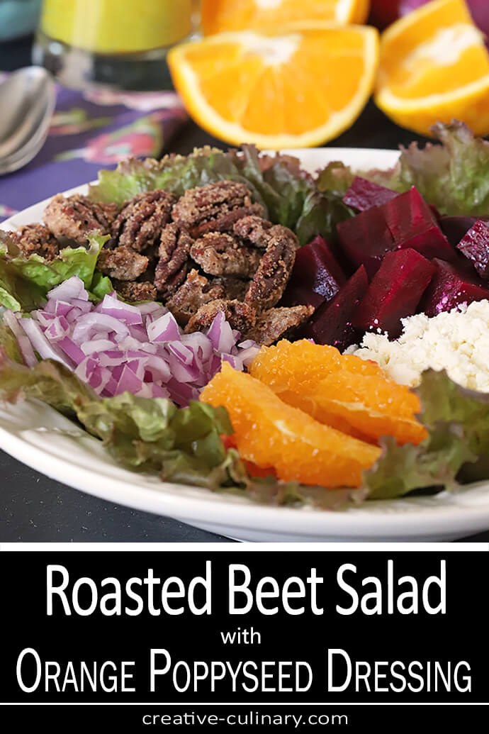 Beet Salad with Oranges, Candied Pecans & Feta Cheese on a Serving Plate with Oranges and Red Onion