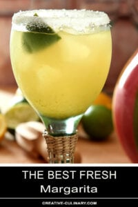 The Best Fresh Margarita Served in a Tall Green Glass and Garnished with Lime