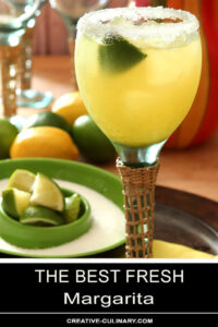 The Best Fresh Margarita on A Serving Tray with Lime Wedges