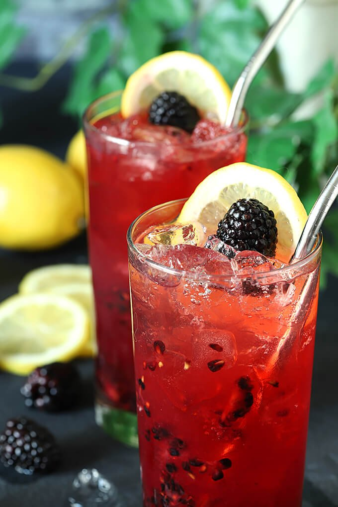Blackberry Bourbon Collins Cocktails with Lemon and Blackberry Garnish