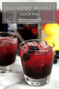 Blackberry Bramble Cocktail in Lowball Glasses Garnished with Blackberries