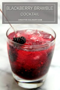 Blackberry Bramble Cocktail in Lowball Glass and Garnished with Blackberries