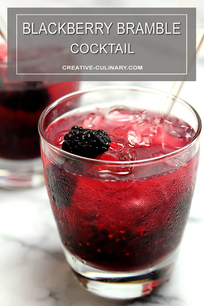 Blackberry Bramble Cocktail in Lowball Glass and Garnished with a Whole Blackberry