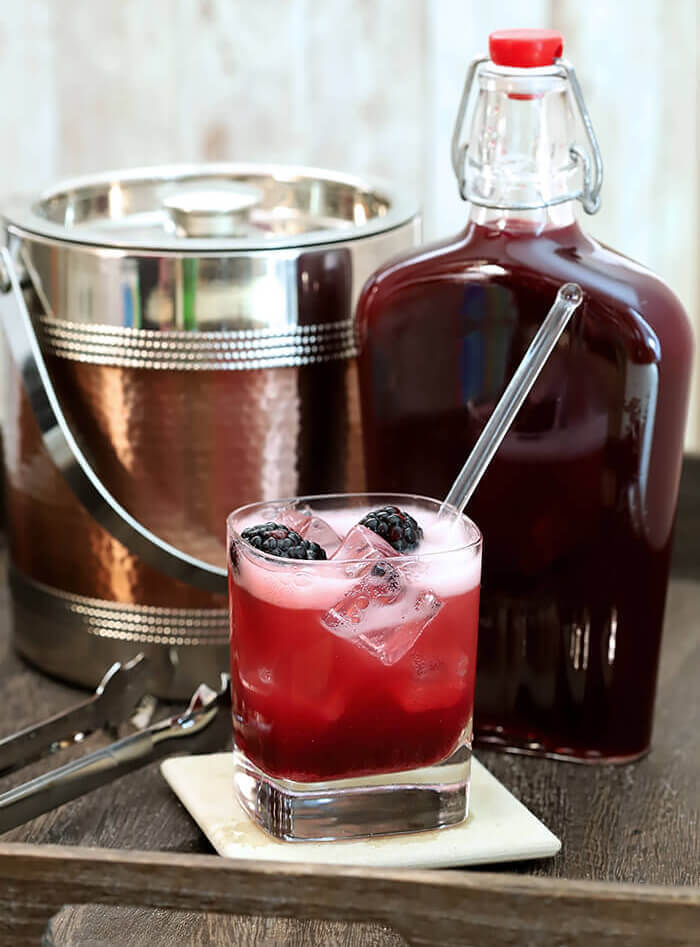 Homemade Crème de Mûre (Blackberry Liqueur) Served with Prosecco and fresh blackberries.