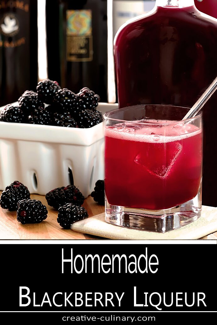 Homemade Blackberry Liqueur with fresh berries and a glass of liqueur and Prosecco.