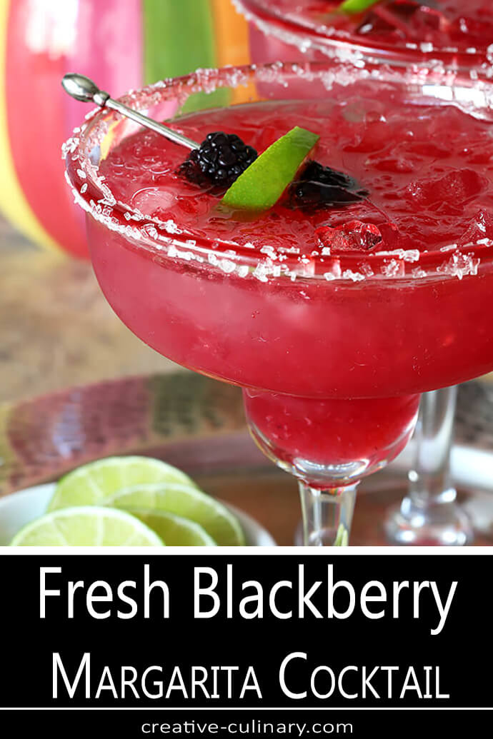 Closeup of Fresh Blackberry Margarita Cocktail Garnished with Sanding Sugar, Blackberries, and Lime Slice
