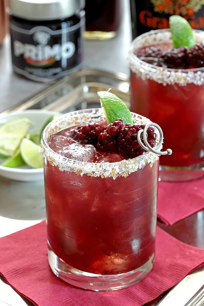 Blackberry Serrano Margarita Garnished with Blackberries and Lime Wedge