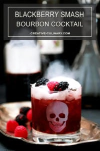 Sparkling Blackberry Smash Cocktail in Highball Glass and Garnished with Berries
